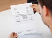 man looking at invoice