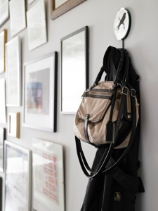 Coat and bag hanging on a hook